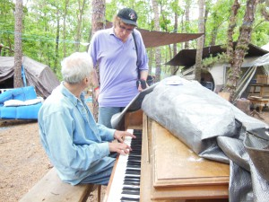 with Michael as he wondrously plays the piano in front of his tent.