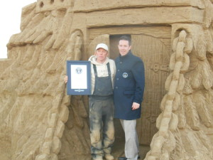 Ed Jarrett with his Guinness  World Record plaque with Philip Robertson from Guinness