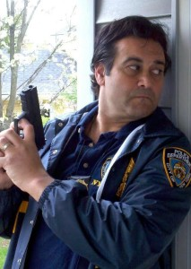 Garry Pastore playing a NYC cop