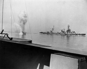 A-heavy-German-coast-artillery-shell-falls-between-USS-Texas-and-USS-Arkansas-while-the-two-battleships-engage-Battery-Hamburg.