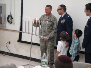 Base Commander Frederick D. Thaden lighting Menorah